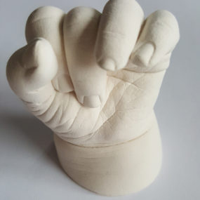 Unpainted baby hand cast