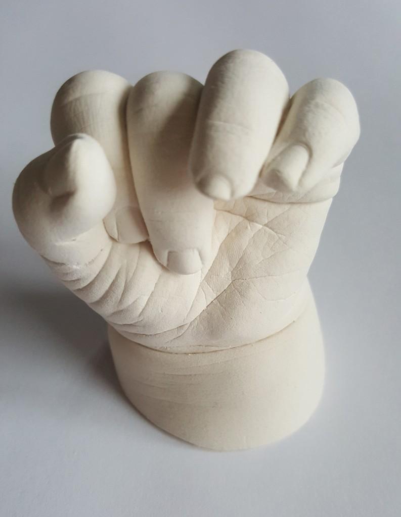 Unpainted baby hand cast