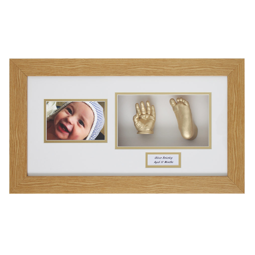 Wood & gold framed baby cast. Hand & foot