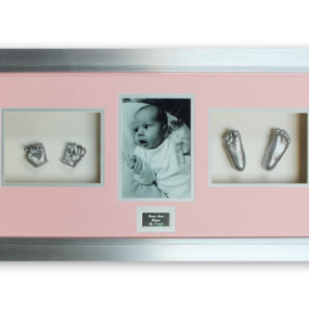 Baby pair of hands & feet cast in a landscape pink & silver frame