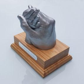 silver-hands-light-wood-plinth-3
