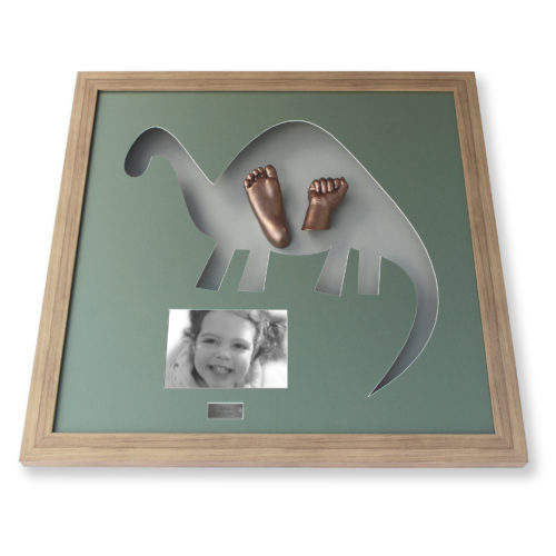 Dinosaur shaped animal casting with inset photo