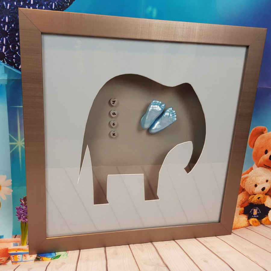New boys bedroom elephant shaped frame with feet casts as ears