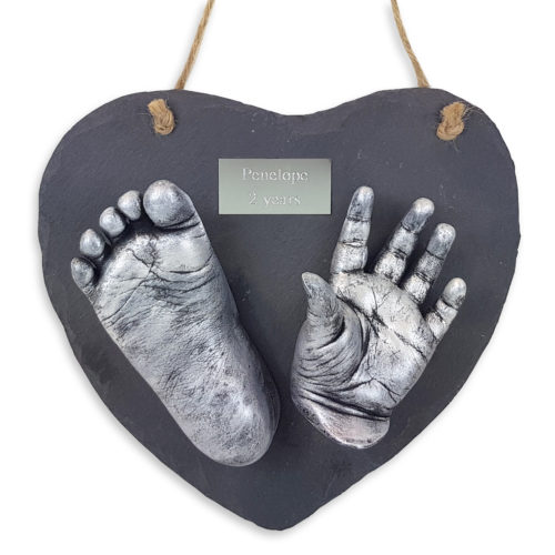 Two casts with plaque on a heart slate