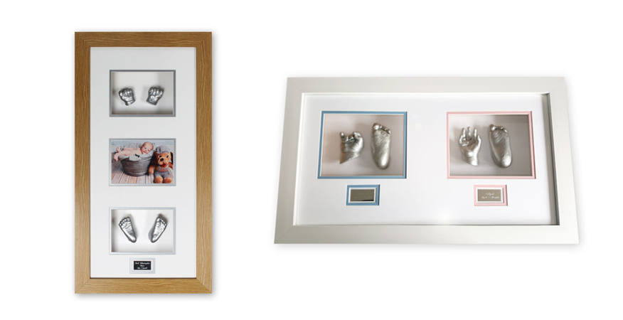 framed baby casts with both pairs of hands and feet