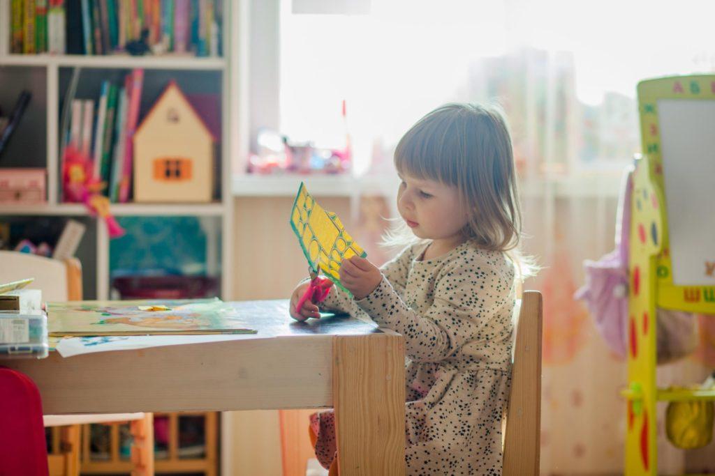 Child cutting paper