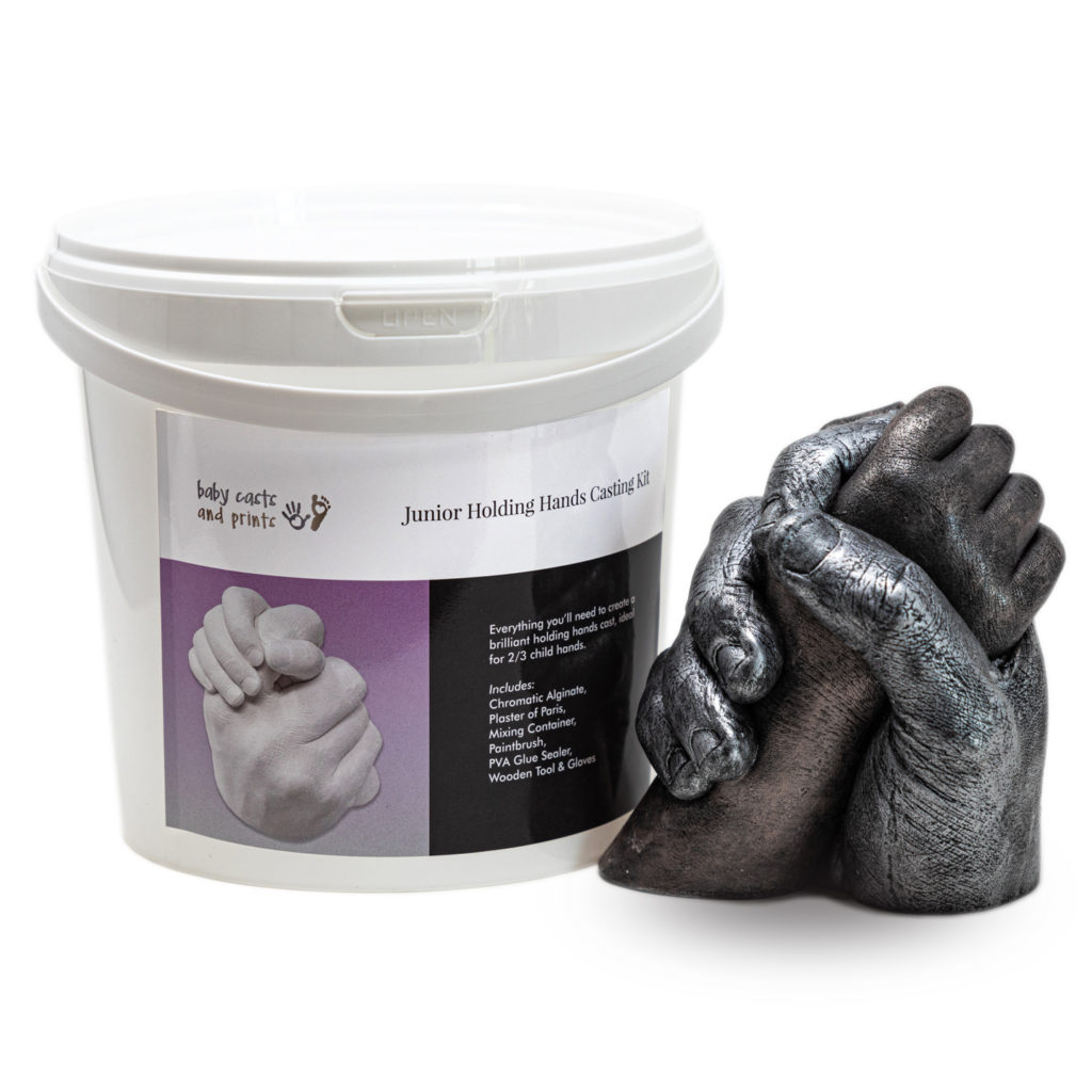 Junior Casting Kit bucket next to child and adult hand cast