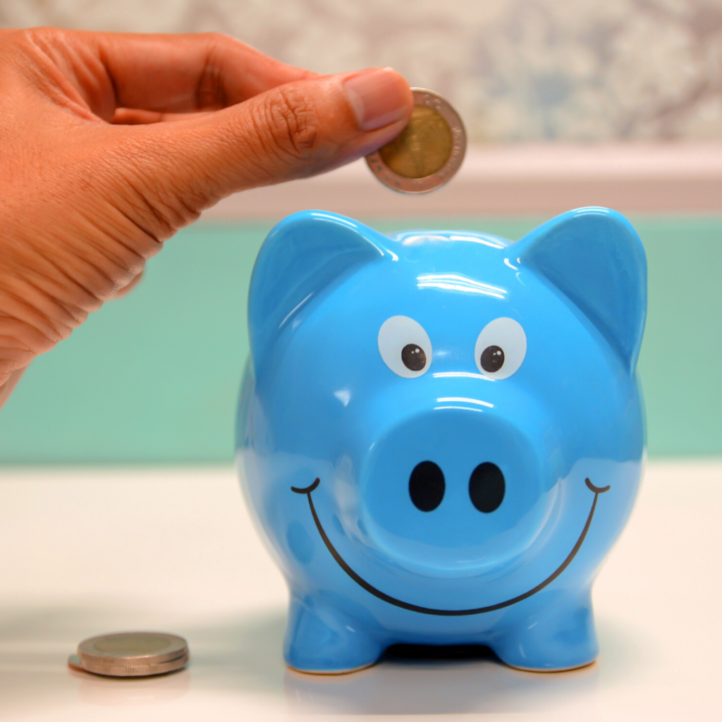 Putting money into a piggie bank