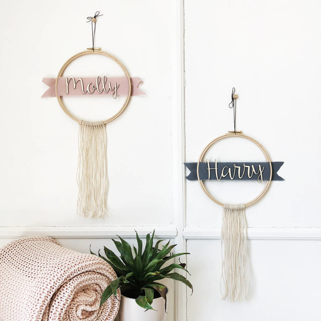 two personalised wall hangings