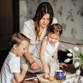 Mother baking with two children