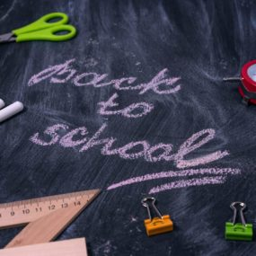 Black board with 'back to school' written